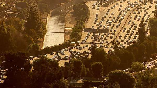 Aerial view of rush hour traffic on busy freeway Royalty-free stock video