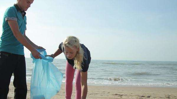 Teenagers Volunteering Beach Cleanup Royalty-free stock video