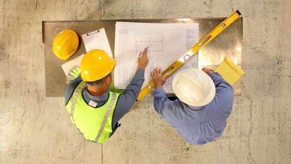 Construction Industry, contractors look over blueprints Royalty-free stock video