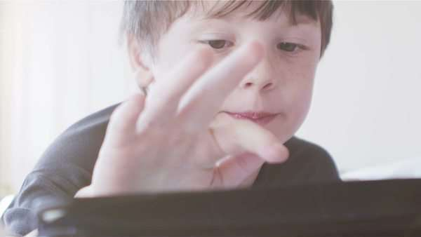 A young boy uses a touchscreen device Royalty-free stock video