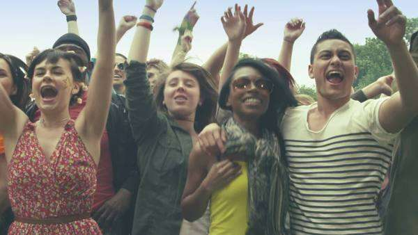 Young crowd of teenagers dancing at a music festival in summer Royalty-free stock video