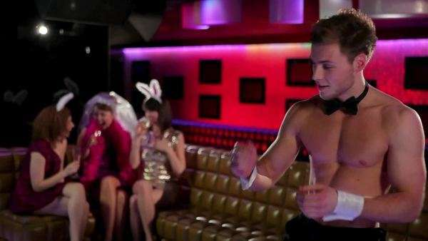 Women at a bachelorette with male stripper pulling off trousers Royalty-free stock video