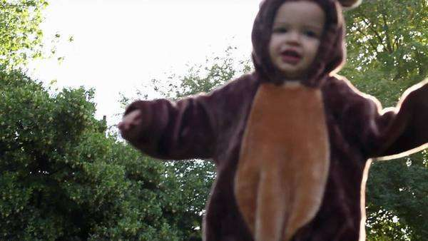 Boy dressed as bear running towards camera Royalty-free stock video