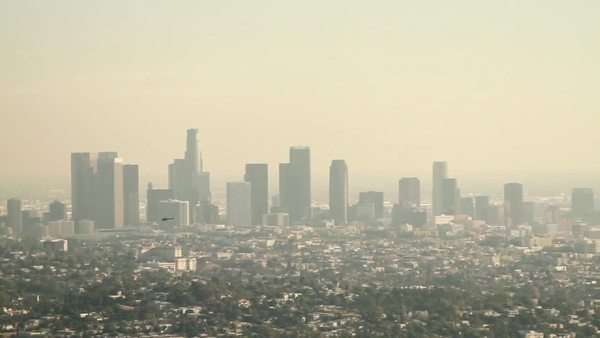 Helicopter flies across Los Angeles skyline Royalty-free stock video
