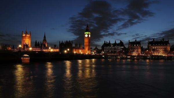 Timelapse of Big Ben, Palace of Westminster, and the Thames River at night. Royalty-free stock video