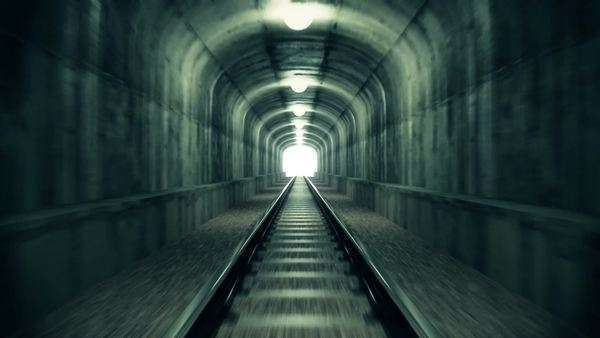 Ride through an old-looking rail tunnel with a light at the end Royalty-free stock video