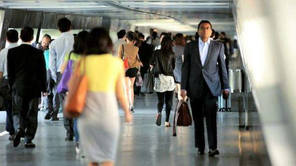 Hong Kong - November 2013: Morning commuters walking to work in a busy city environment blurred slow motion Royalty-free stock video