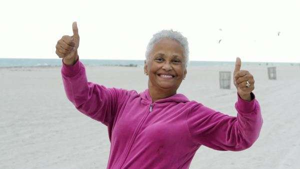 Senior African American woman on the beach Royalty-free stock video