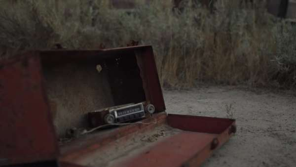 Rack shot of abandoned car and metal box with radio in desert Royalty-free stock video
