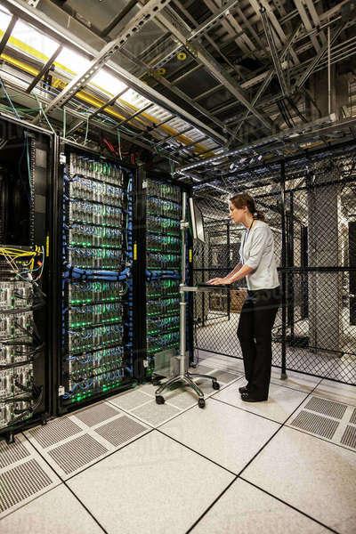 Caucasian Woman Technician Working On Computer Servers In