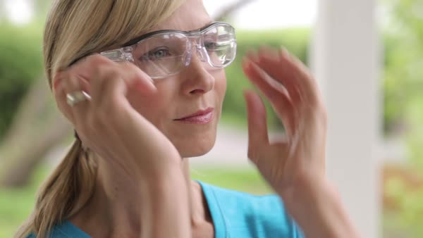 Close-up of confident female carpenter wearing protective glasses outdoors Royalty-free stock video