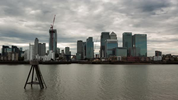 Stormy clouds move over Canary Wharf in late afternoon. Royalty-free stock video