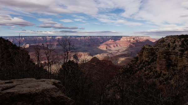 Wide shot of Grand Canyon as clouds roll overhead before a rainstorm. Royalty-free stock video