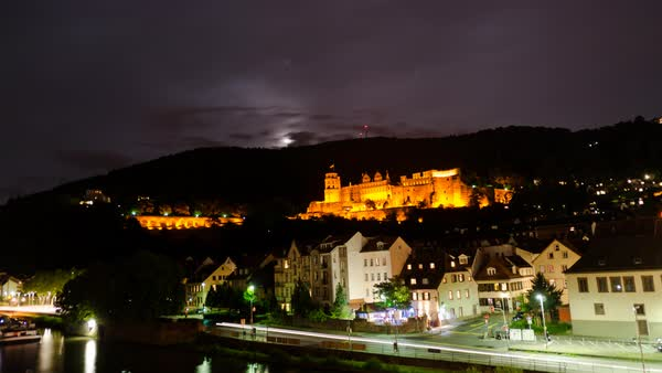 Clouds and the moon fly over Heidelberg Castle at night. Royalty-free stock video