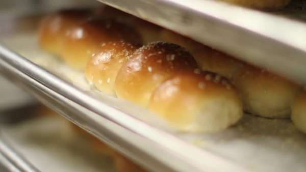 Close-up shot of freshly baked buns on a baking tray Royalty-free stock video
