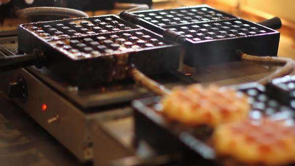 Close-up shot of a person preparing waffels Royalty-free stock video