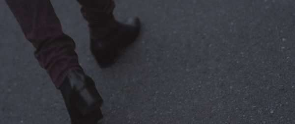 Close-up shot of a  person walking on the road Royalty-free stock video