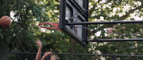 Close-up shot of people playing street basketball Royalty-free stock video
