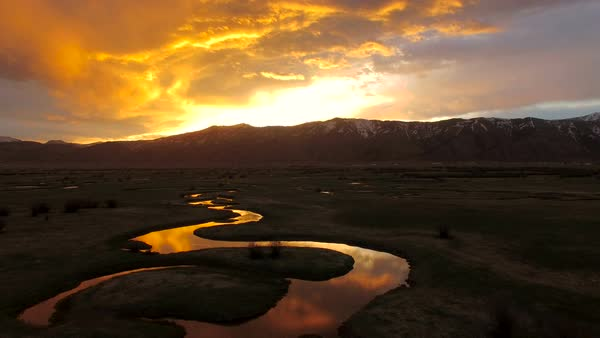 Ariel view of sunrise above winding river in Wyoming. Royalty-free stock video