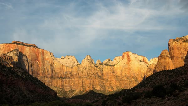 Timelapse of cliffs lighting up at sunrise in Zion National Park Royalty-free stock video