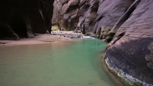 View of a teal pool in a river in Zion National Park Royalty-free stock video