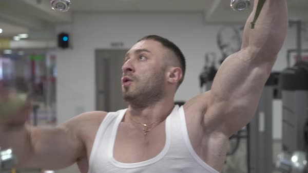 Demonstration of bodybuilder preparing to exercises with so big biceps   stock footage