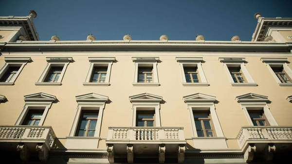 Low angle wide view of a neo classical building in the downtown business district of Athens,Greece. Royalty-free stock video