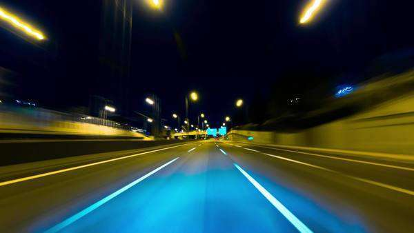 Drive pov modern highway timelapse/hyperlapse night. Pov night driving hyperlapse at a modern highway passing a series of tunnels. Camera is placed outside the vehicle and level is horizontal, giving an illusion of teleporting through an endless series of twists, turns, and tunnels at high speeds. Royalty-free stock video