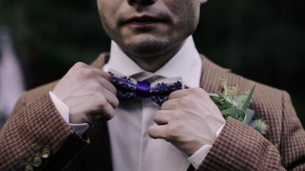 Close up shot of a man adjusting his bow tie Royalty-free stock video