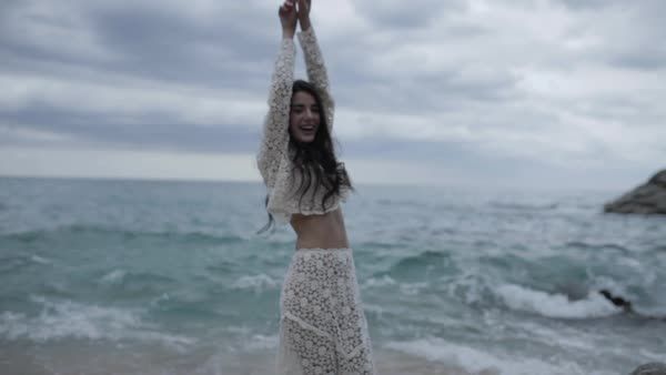 Medium shot of a woman posing on a beach Royalty-free stock video