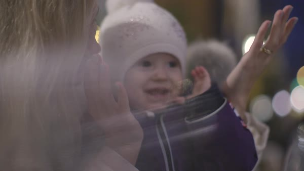 Hand-held shot of a mother playing peekaboo with her child Royalty-free stock video