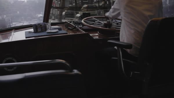 Back view of a helmsman steering a boat in Amsterdam Royalty-free stock video