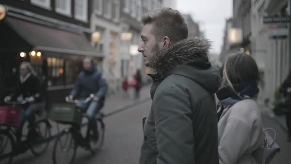 Hand-held shot of a couple crossing a street in Amsterdam Royalty-free stock video