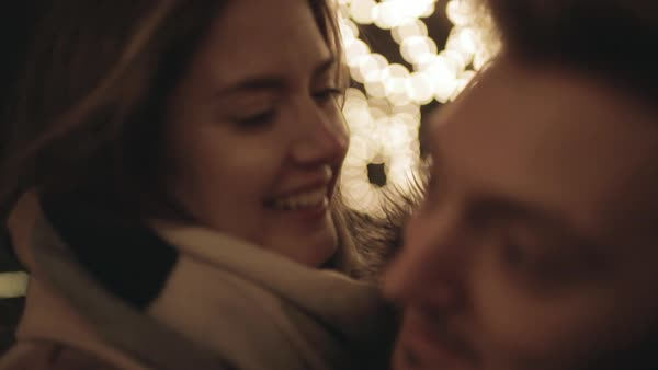 Hand-held shot of a couple embracing at night Royalty-free stock video