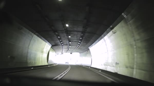 Point-of-view shot from a car leaving a tunnel Royalty-free stock video
