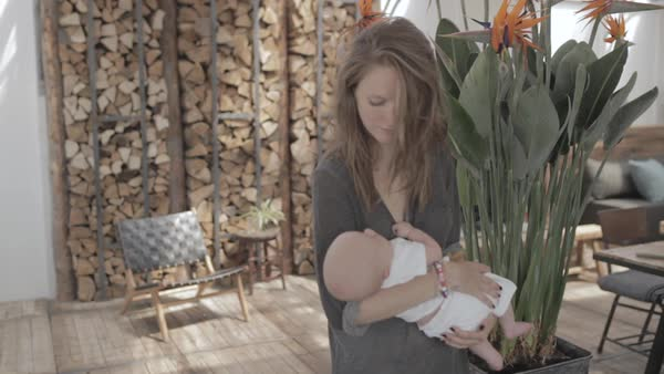 Hand-held shot of a mother cradling her baby Royalty-free stock video