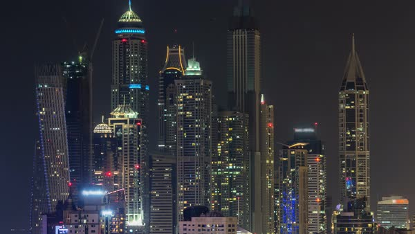 Beautiful Aerial Top View At Night Timelapse Of Dubai Marina Skyscrapers In UAE Illuminated Modern Towers With Blinking Lights