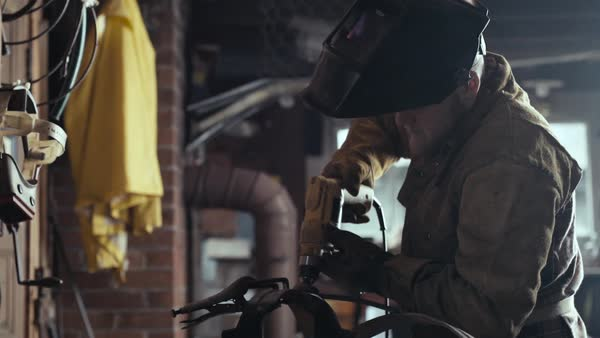 Slow motion of a man polishing metal in a workshop Royalty-free stock video