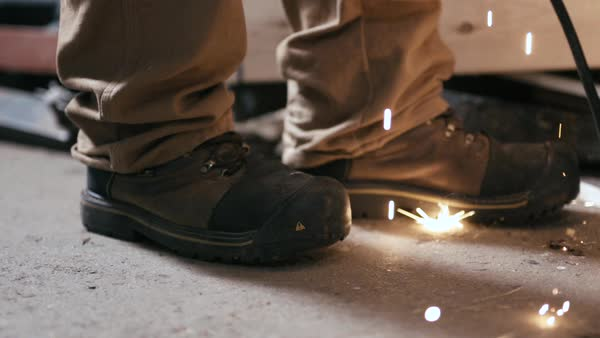 Slow motion of sparks at the feet of a welder Royalty-free stock video