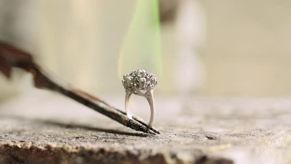 Close up shot of a flaming ring being held with tweezers Royalty-free stock video
