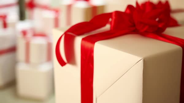 Close Up Shot Of White Gift Boxes With A Red Ribbons Zoom In Stock Footage