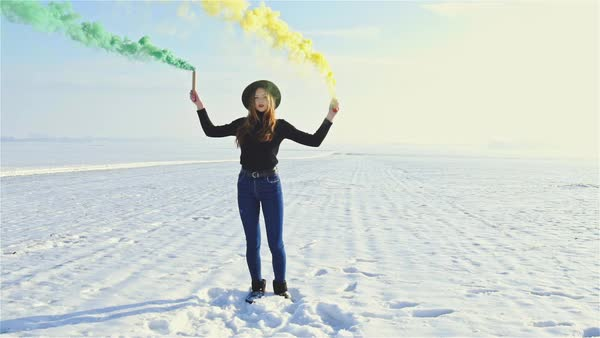 Woman dancing with colored smoke bombs stock footage