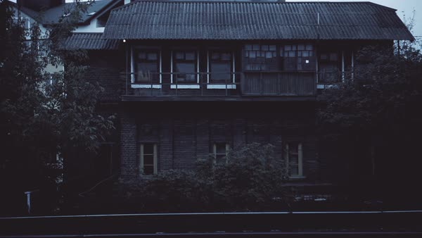 Ghost of woman in the window of an abandoned house  stock footage