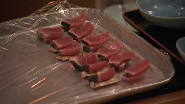 Hand-held shot of sushi chefs preparing dishes Rights-managed stock video