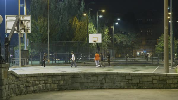 Static shot of young men playing basketball in Cal Anderson Park in Seattle, Washington Rights-managed stock video