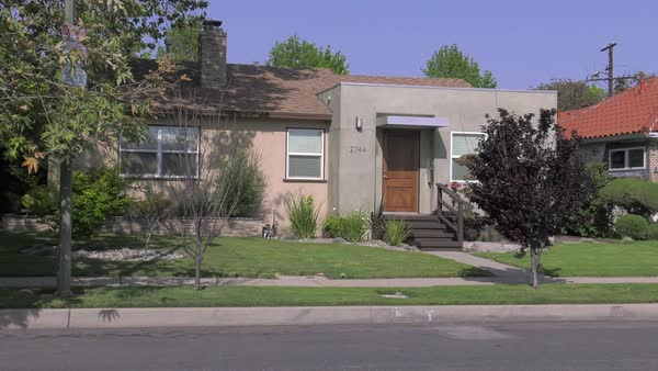 Zooming in shot of a middle class house in Los Angeles Rights-managed stock video
