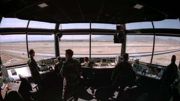 Static shot of people in military air force control room Rights-managed stock video