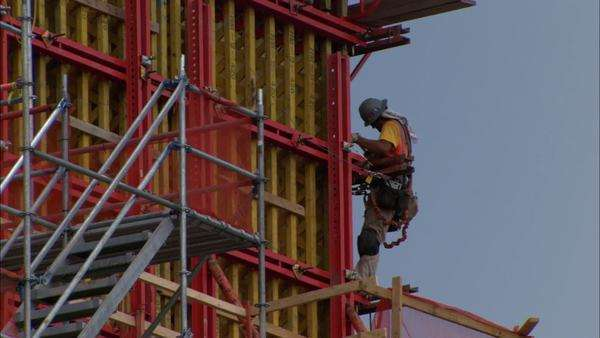 Hand-held shot of a high-rise building under construction Rights-managed stock video