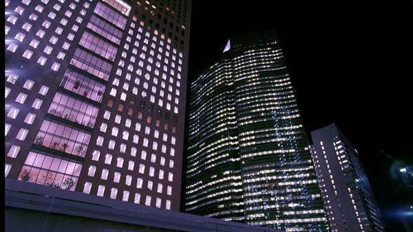 Low-angle shot of office buildings at night in Tokyo Rights-managed stock video