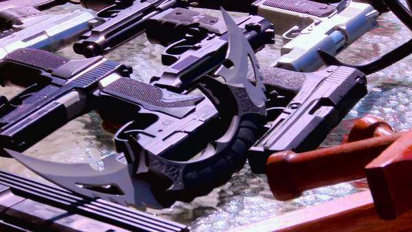 Panning shot of confiscated weapons Rights-managed stock video